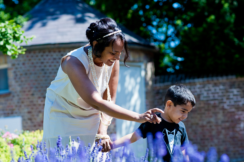 Bride and son looking at the flowers outside Merton Registry Office