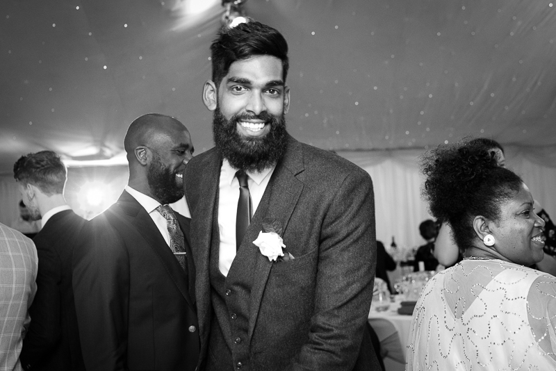 Groom smiling at Noke hotel wedding