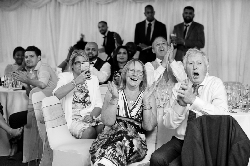Guests reacting to speeches at Noke Hotel St Albans