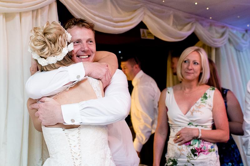 Wedding guests congratulating bride and groom at Noke Hotel