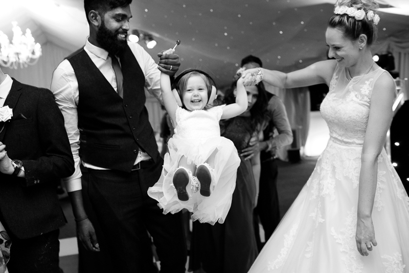 Bride and groom dancing with flower girl at Noke hotel