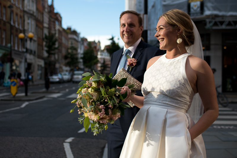 Bride and groom look for taxi after Asia House wedding