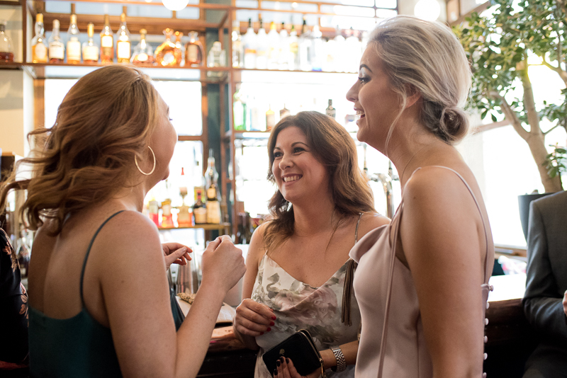 Wedding guests having fun in pub