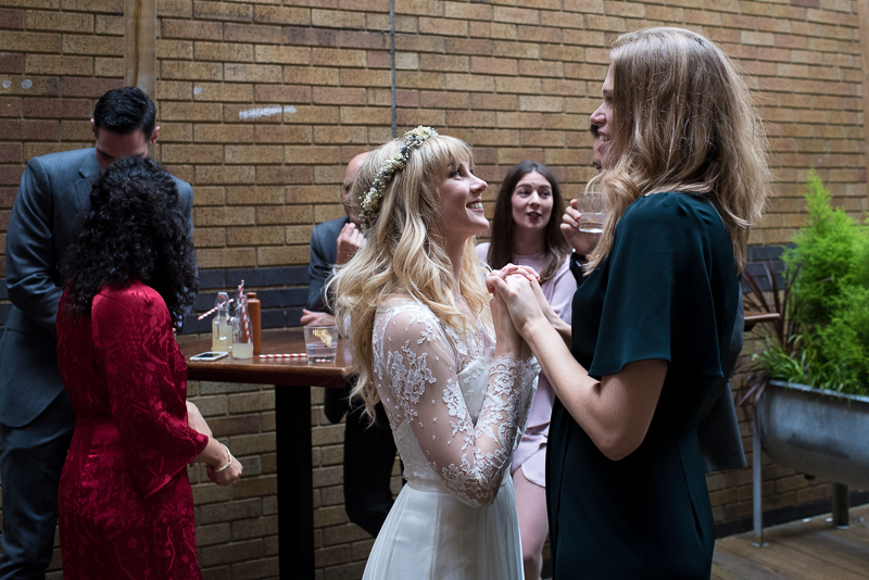 Bride chats to friends at Tanner Warehouse