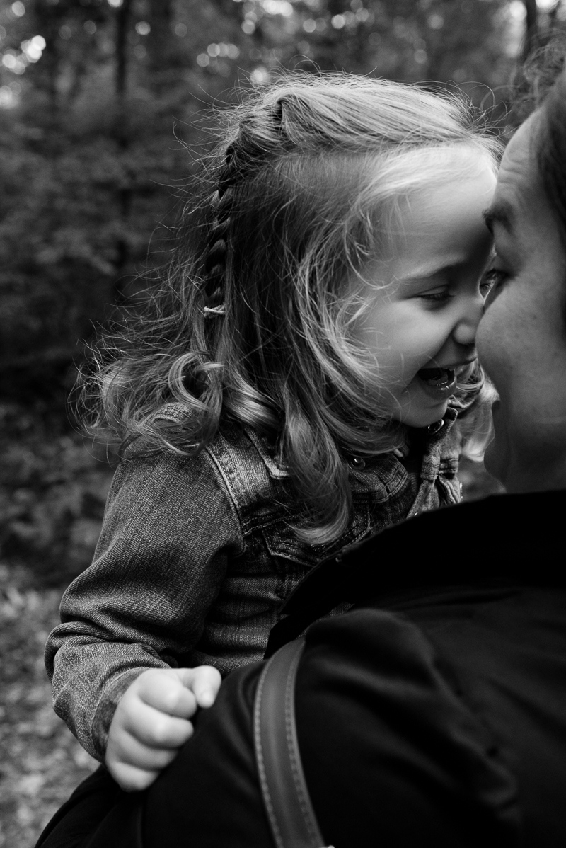 Mother cuddles daughter during Muswell Hill Family Photography session