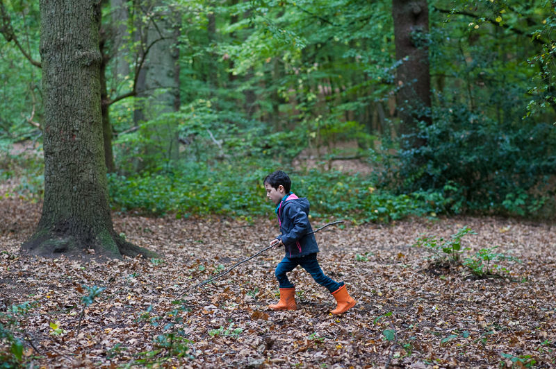 Boy runs through Coppetts Wood
