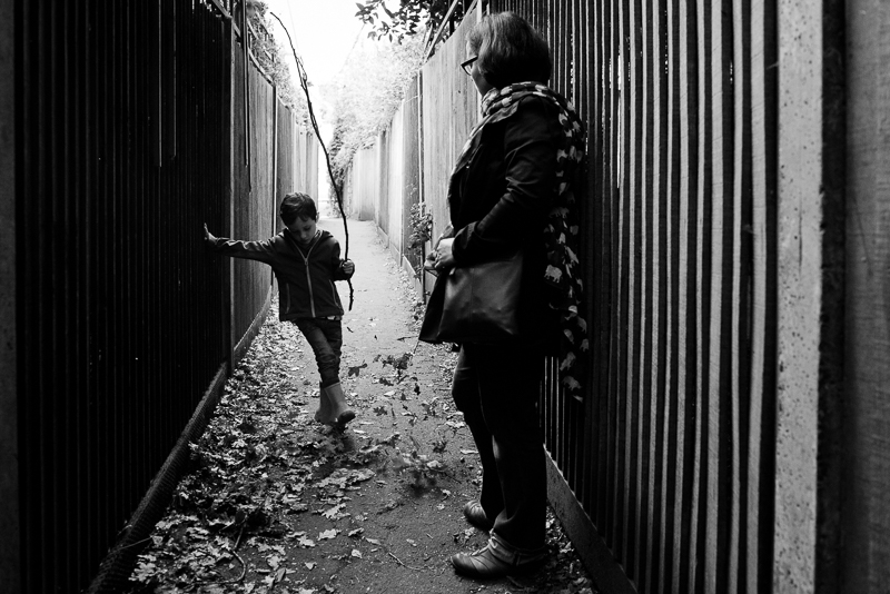 Mother and son play in alleyway in Muswell Hill