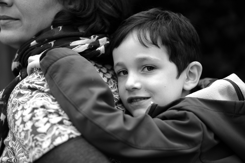 Mother give son a piggy back during Muswell Hill Family photography session