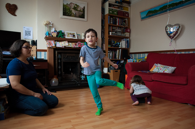 Brother and sister dance around the flat in natural family photography session