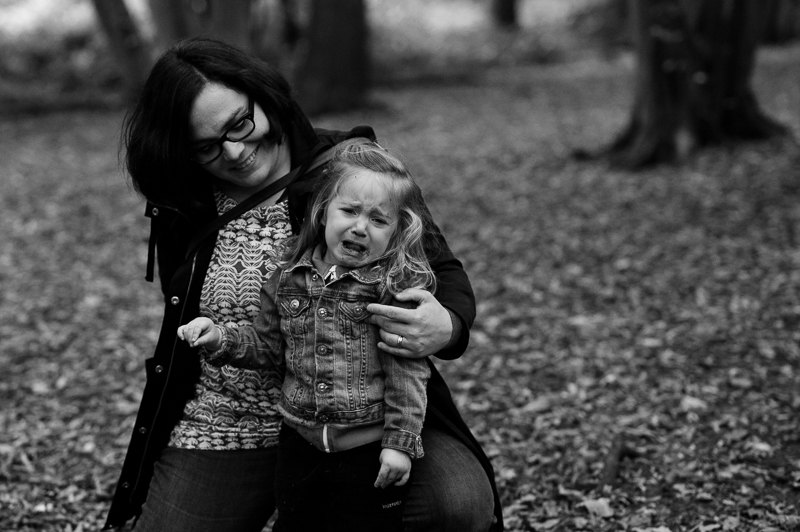 Mother comforts daughter during natural family photography session