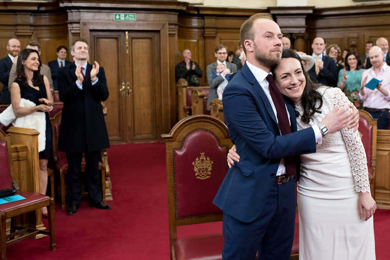 Groom hugs bride during Islington Town Hall wedding