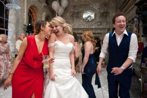 Bride and friend on the dancefloor at Aynhoe wedding reception