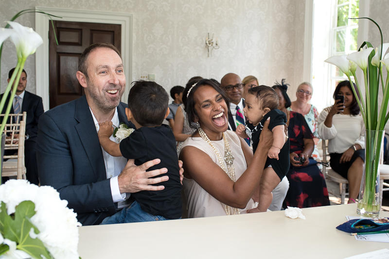 Bride and groom with children at Merton Registry Office Wedding