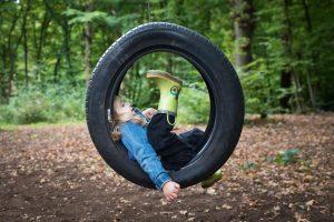 Girl on tyre swing in Coppetts Wood
