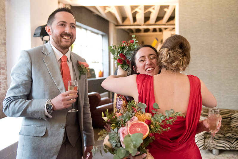 Bride hugs sister at One Friendly Place wedding