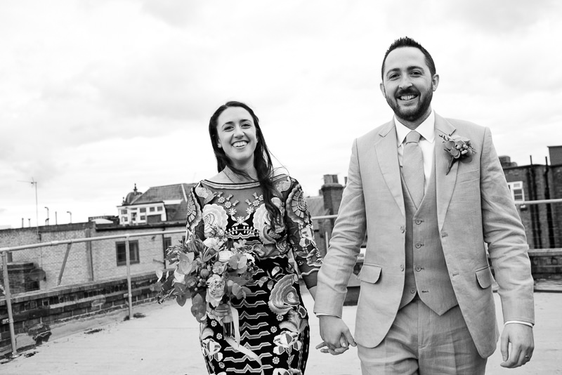 Bride and groom on roof terrace at One Friendly Place