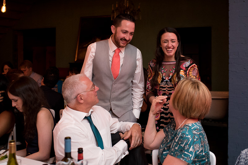 Bride and groom mingle with guests at One Friendly Place wedding