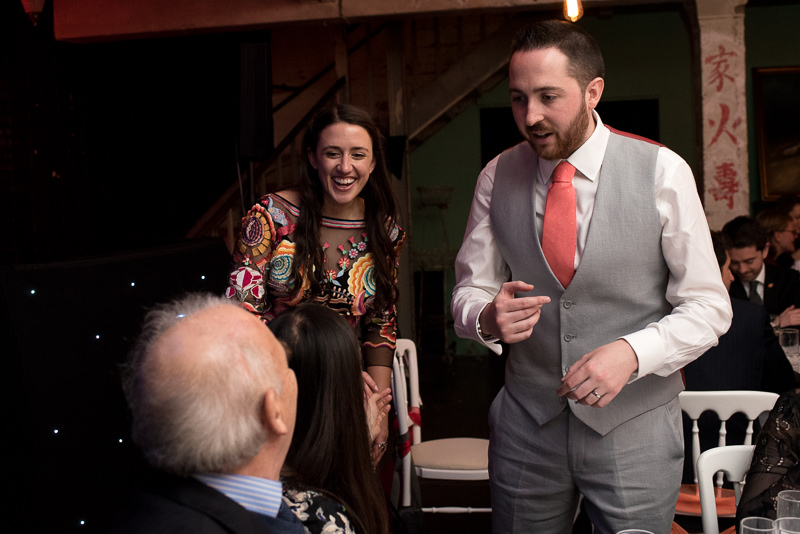 Bride and groom talk to guests during wedding reception at One Friendly Place