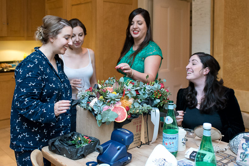 Bridesmaids looking at flowers