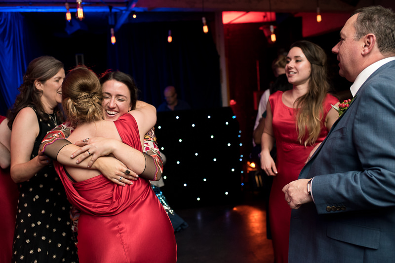 Bridesmaids in red dresses at One Friendly Place