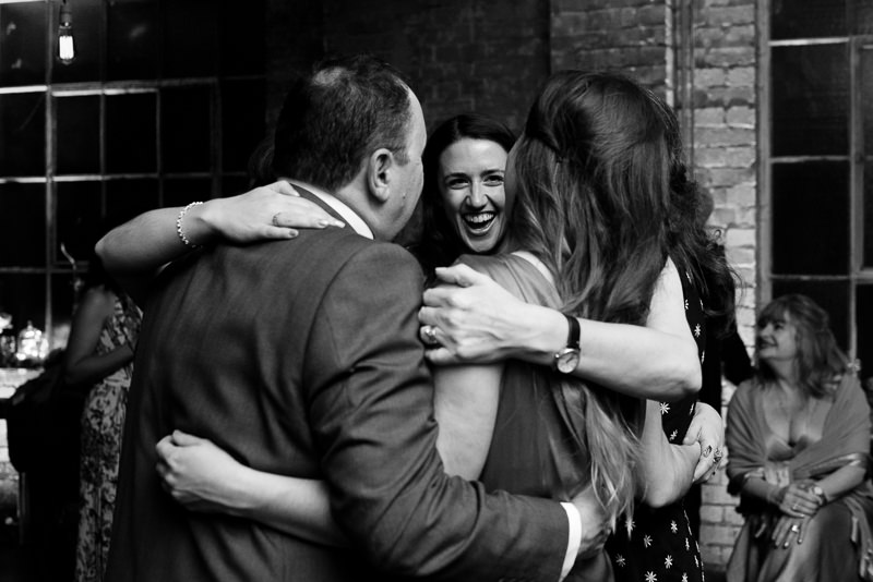 Bride dances with family at One Friendly Place