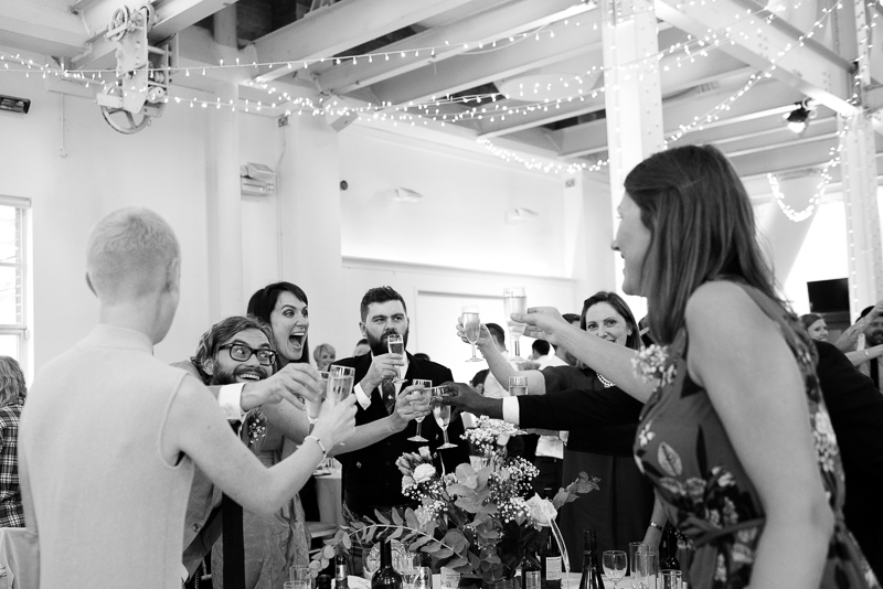 Guests toast bride and groom at West Reservoir Centre wedding