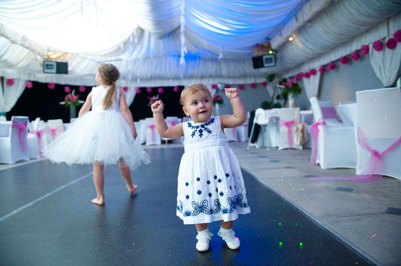 Toddler on dance floor at child-friendly wedding