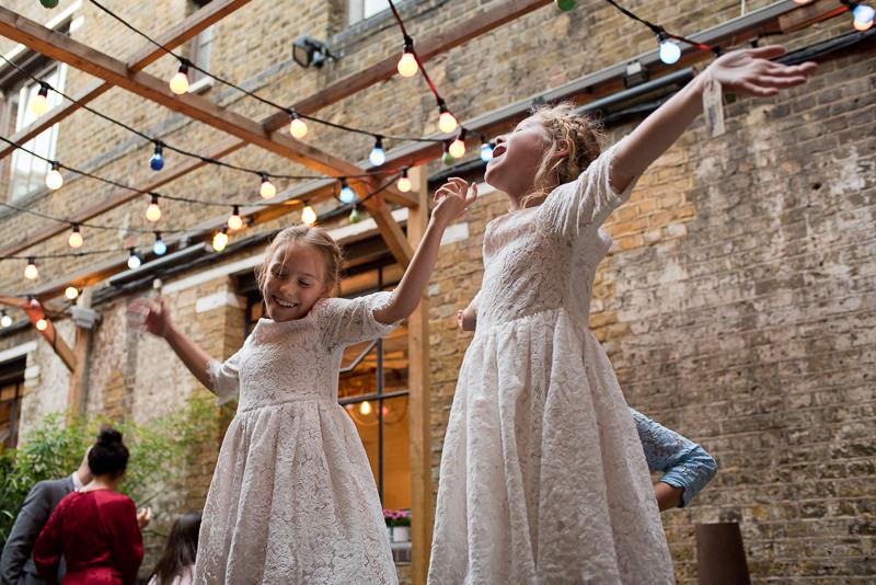 Flowergirls dancing at child-friendly wedding