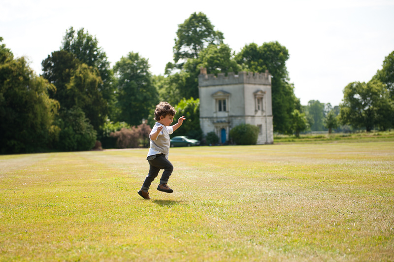 Boy playing in a field at child-friendly wedding