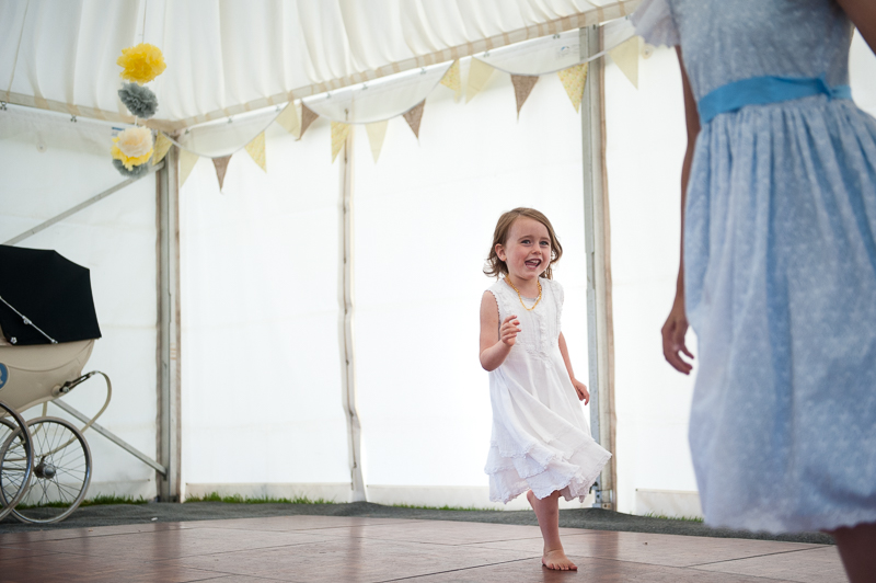 Child running around on dancefloor at child-friendly wedding