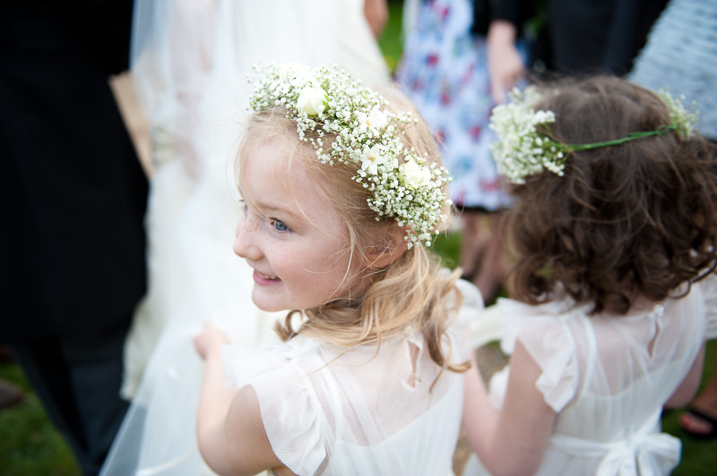 Flower girl carrying veil at child-friendly wedding