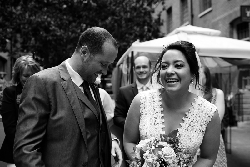 Bride and groom laughing at Devonshire Terrace wedding