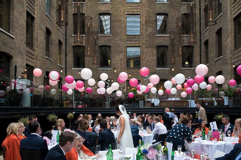 Bride mingles with guests at Devonshire Terrace wedding