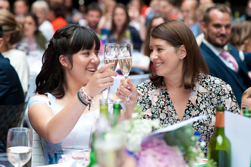 Guests raise a glass at Devonshire Terrace wedding