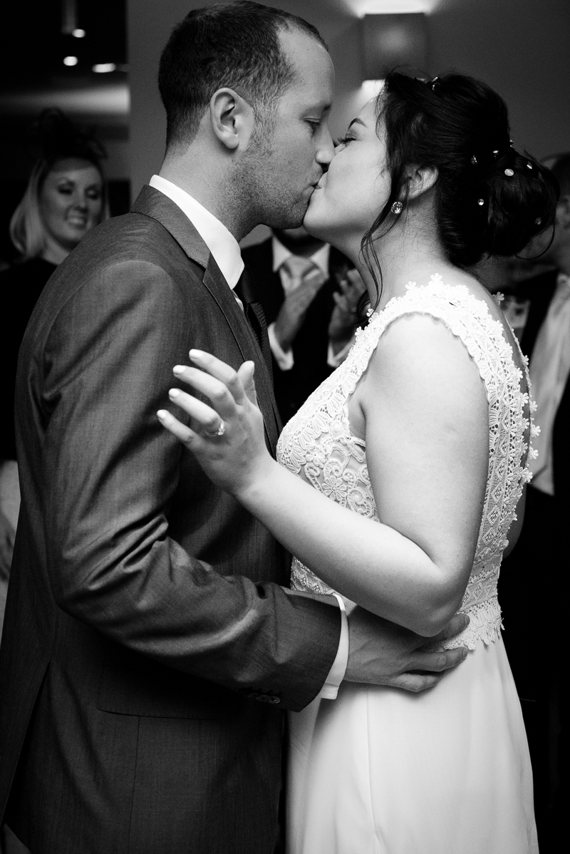 Bride and groom kiss at Devonshire Terrace wedding