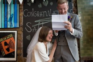Bride and groom laugh and cry during speeches at The Londesborough in Stoke Newington