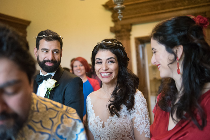 Bride and groom during greek wedding ceremony at Boreham House