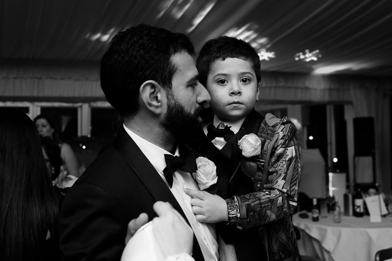Groom with nephew at wedding at Boreham House