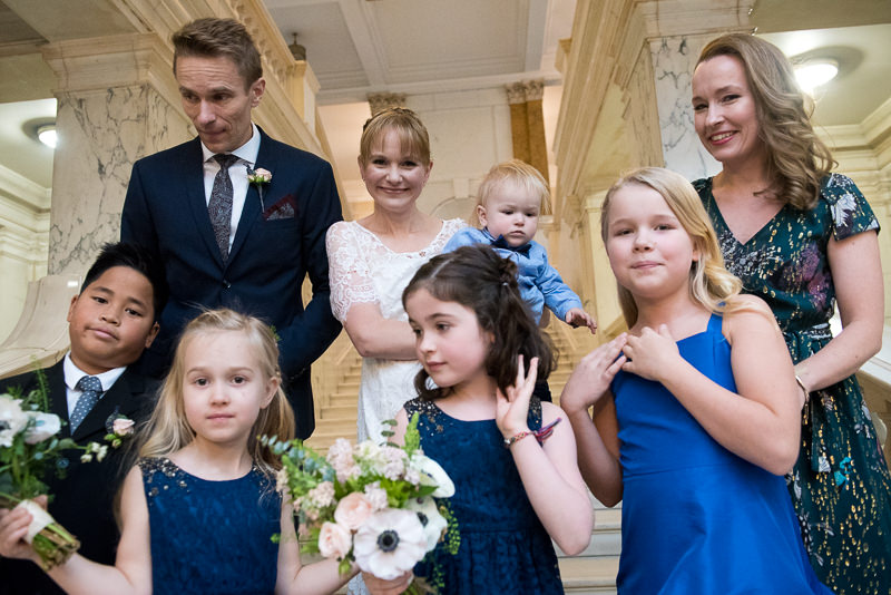 Bride and groom with flower girls at Camden town Hall