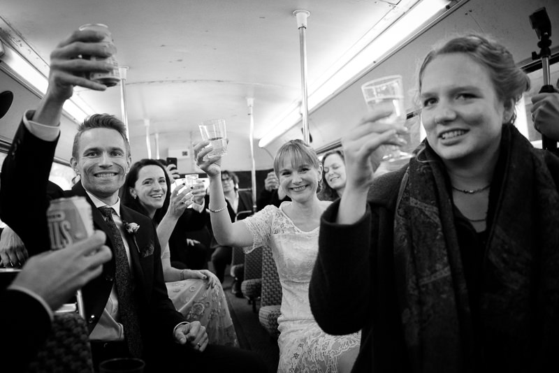 Bride and groom with wedding party on London red bus