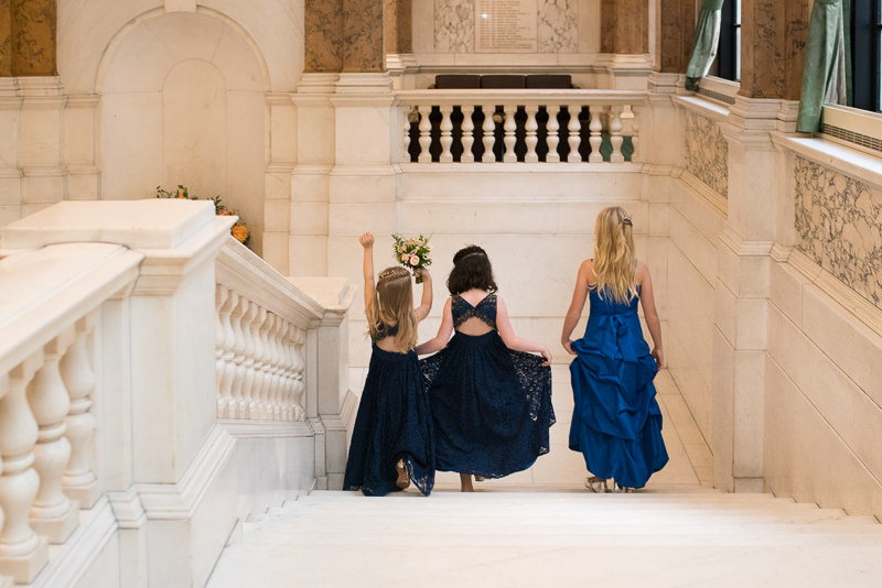 Flower girls on staircase at Camden Town Hall wedding