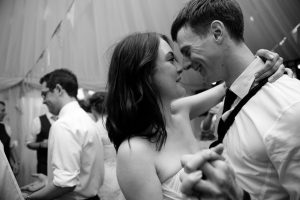Black and white photo of couple dancing at London wedding