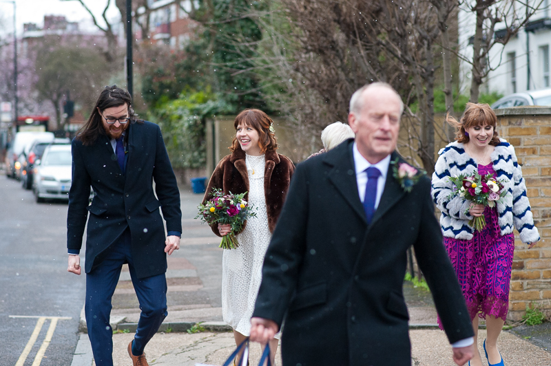 Bride and groom walk to Londesborough Pub from Stoke Newington Town Hall