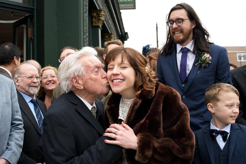 Grandpa kisses bride at Stoke Newington wedding