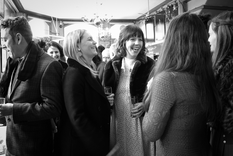 Bride chats to friends at Stoke Newington wedding