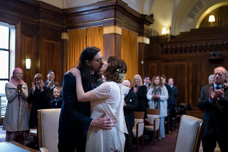 Bride and groom kiss at Stoke Newington wedding