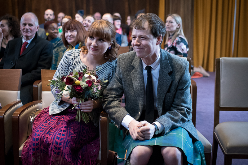 Guests watch Stoke Newington wedding in the town hall