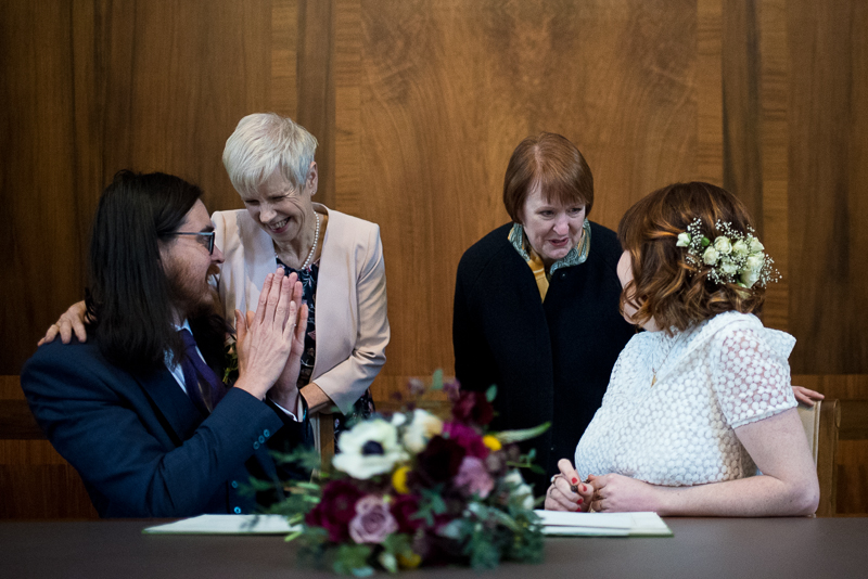 Mothers congratulate bride and groom at Stoke Newington Town Hall