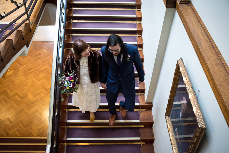 Couple on stairs in town hall in Stoke Newington