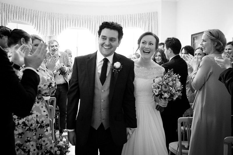 Black and white photograph of bride and groom at Cambridge Cottage wedding ceremony